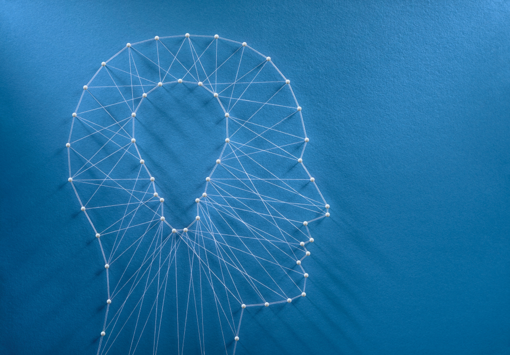 Head made of pins and threads suggesting new ways of thinking