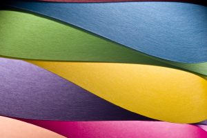 Interleaved coloured paper to represent diversity